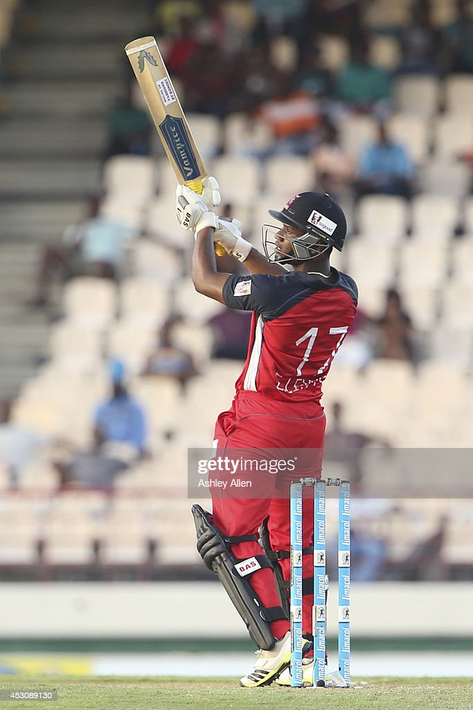 Evin Lewis of The Red Steel cuts behind square for six during a match between St. Lucia Zouks and The Trinidad and Tobago Red Steel as part of week 4 of the Limacol Caribbean Premier League 2014 at Beausejour Stadium on August 02, 2014 in Castries, St. Lucia.