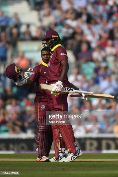 Evin Lewis of West Indies celebrates reaching his century with captain Jason Holder during the 4th Royal London One Day International between England...