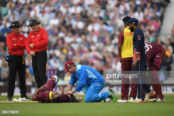Evin Lewis of West Indies grimaces after being hit by the ball during the 4th Royal London One Day International between England and West Indies at...