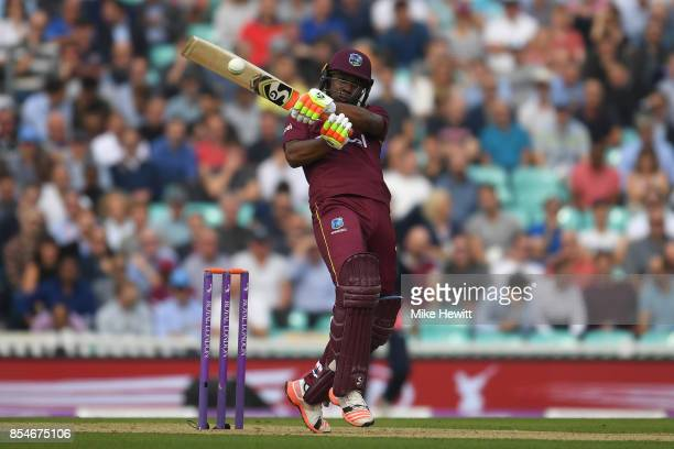 Evin Lewis of West Indies hits a boundary during the 4th Royal London One Day International between England and West Indies at The Kia Oval on...