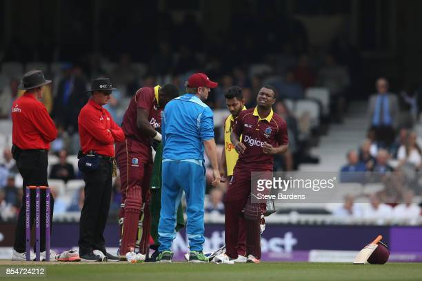 Evin Lewis of West Indies is injured in the ankle and is forced to retire during the 4th Royal London One Day International between England and West...