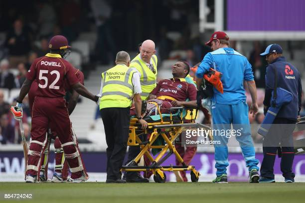 Evin Lewis of West Indies is injured in the ankle and is stretchered off during the 4th Royal London One Day International between England and West...