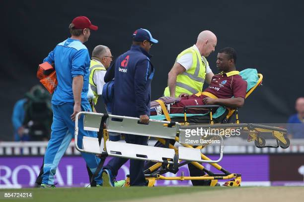 Evin Lewis of West Indies is injured in the ankle and leaves the field on a stretcher during the 4th Royal London One Day International between...