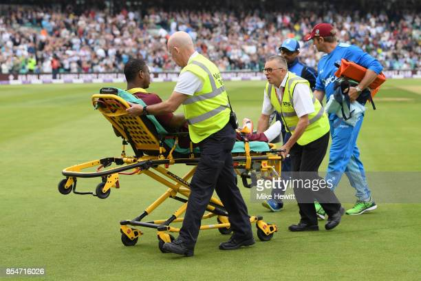Evin Lewis of West Indies is stretchered off after being hit by the ball during the 4th Royal London One Day International between England and West...