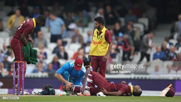 Evin Lewis of West Indies receives treatment to his injured ankle during the 4th Royal London One Day International between England and West Indies...
