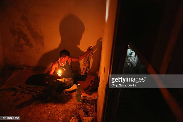 Evis Leyva Carballo sits on the pad he uses for a bed inside an abandoned building he calls home along the Malecon oceanfront drive January 21 2015...