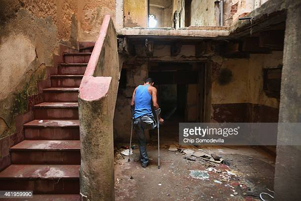 Evis Leyva Carballo uses crutches to move around on one leg inside the abandoned building he calls home along the Malecon oceanfront drive January 21...