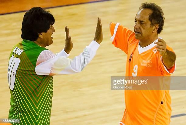 "Evo Morales President of Bolivia and Daniel Scioli Governor of Buenos Aires greet during a Copa Juana Azurduy match at Villa La ""Ñata Stadium as part..."