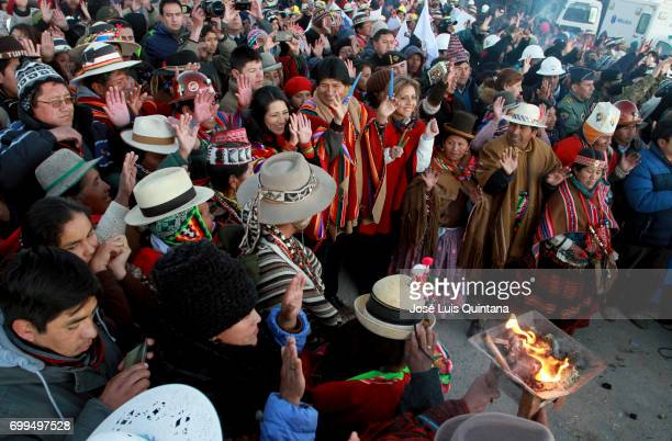 Evo Morales President of Bolivia raises his hands to receive the first sunbeams of the AndeanAmazonic New Year 5525 on June 21 2017 in Orinoca Bolivia