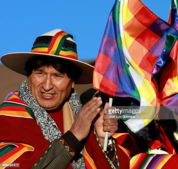 Evo Morales President of Bolivia receives the first sunbeams of the AndeanAmazonic New Year 5525 on June 21 2017 in Orinoca Bolivia