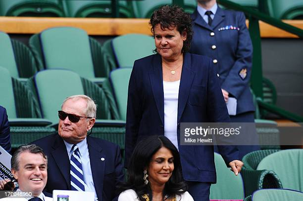 Evonne GoolagongCawley walks past Jack Nicklaus as she makes her way to her seat in the Royal Box on Centre Court during day seven of the Wimbledon...