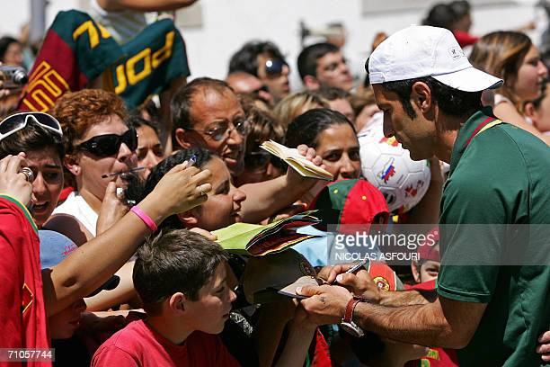 Portugal's Luis Figo signs autographs in front of the Roman temple of Diana in Evora 100 km south east of Lisbon 26 May 2006 The Portuguese squad...