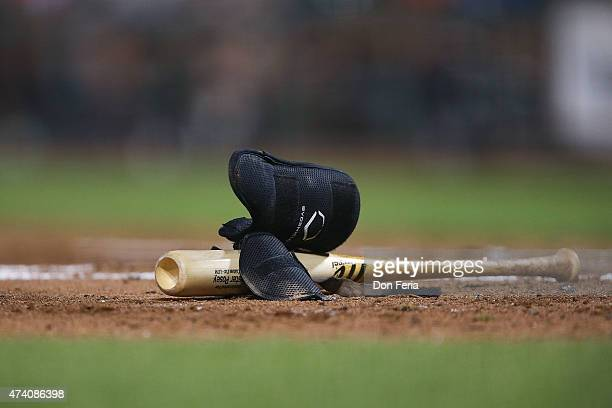 Evoshield protective gear and bat sit on the infield for Catcher Buster Posey of the San Francisco Giants in between play between the San Francisco...