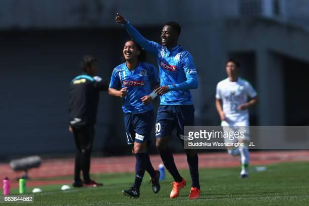 Evson of Kamatamare Sanuki celebrates scoring his team's second goal with his team mate Kenji Baba during the JLeague J2 match between Kamatamare...
