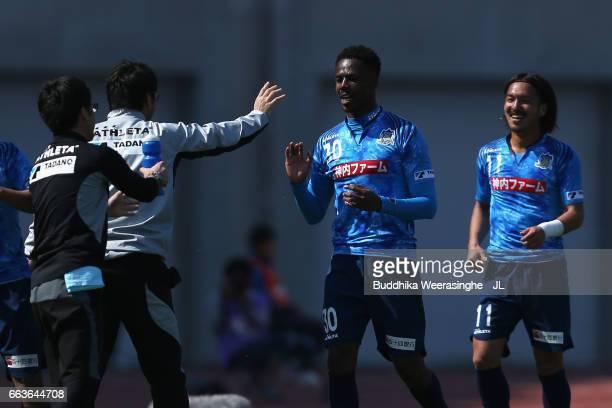 Evson of Kamatamare Sanuki celebrates scoring his team's second goal with his team mates during the JLeague J2 match between Kamatamare Sanuki and...