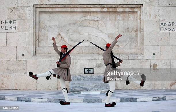 Evzone presidential guards perform ceremonial duties at the tomb of the unknown soldier in Athens Greece on Wednesday June 20 2012 European Union...