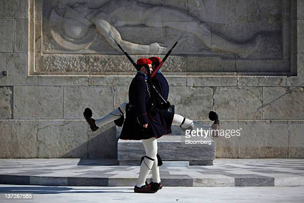 Evzone soldiers parade during guard duty in front of the Greek parliament building on Syntagma Square in Athens Greece on Wednesday Jan 18 2012...