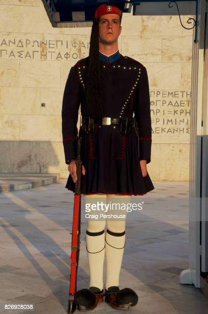 Evzone (Parliament House guard) standing at attention before the Tomb of the Unknown Soldier in Syntagma Square.