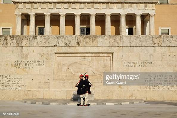 Evzones also known as Tsolias change guards by the tomb of the unknown soldier in front of the Greek parliament located on the corner of Syntagma...