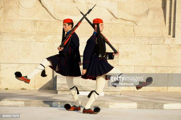 Evzones (Parliament House guards) marching before the Tomb of the Unknown Soldier during the Changing of the Guard ceremony.