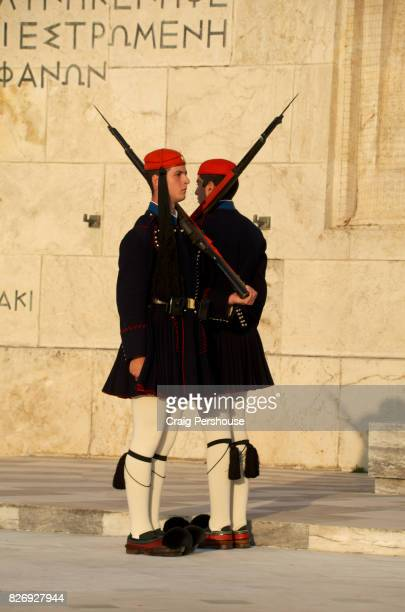 Evzones (Parliament House guards) standing at attention before the Tomb of the Unknown Soldier in Syntagma Square.