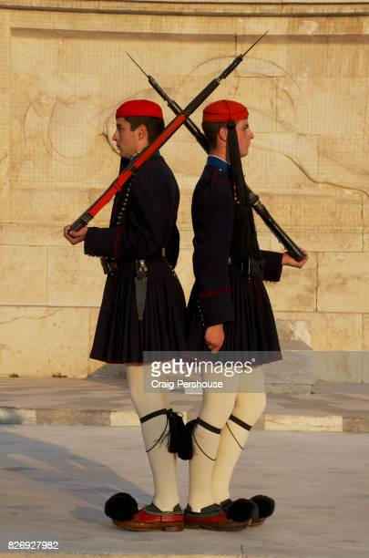 Evzones (Parliament House guards) standing back-to-back before the Tomb of the Unknown Soldier in Syntagma Square.