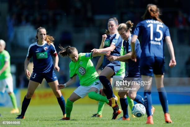 Ewa Pajor of VfL Wolfsburg is challenged by players of Turbine Potsdam during the Allianz Women's Bundesliga match between Turbine Potsdam and VfL...