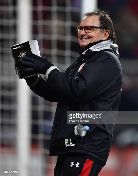 Ewald Lienen head coach of St Pauli celebrates after the Second Bundesliga match between FC St Pauli and Karlsruher SC at Millerntor Stadium on...