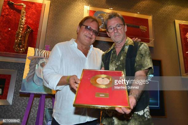Ewald Pfleger and Guenter Grasmuck of Opus pose during the 3rd birthday party of the Hard Rock Cafe Vienna on August 6 2017 in Vienna