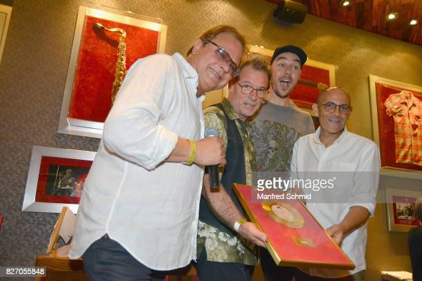 Ewald Pfleger Guenter Grasmuck of Opus Tom Lohner and Joao Santos Da Cunha pose during the 3rd birthday party of the Hard Rock Cafe Vienna on August...
