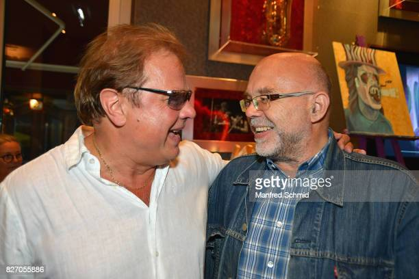 Ewald Pfleger of Opus and Mario Rossori pose during the 3rd birthday party of the Hard Rock Cafe Vienna on August 6 2017 in Vienna