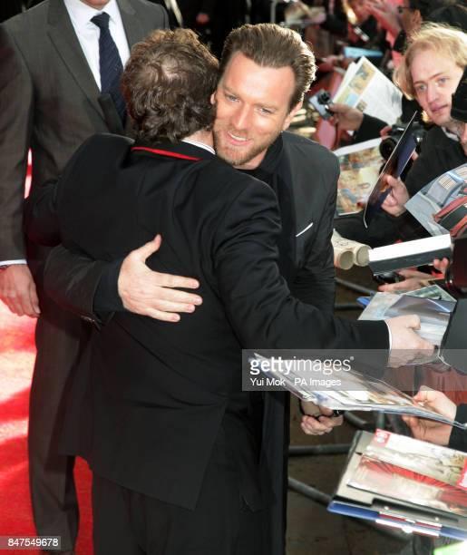 Ewan McGregor embraces Simon Beaufoy who wrote the screenplay at the UK premiere of Salmon Fishing In The Yemen at ODEON Kensington Kensington High...