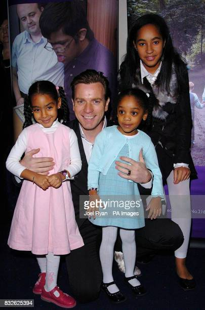 Ewan McGregor with Vinnia Sarah and Natasha from Barnado's Project Feta at the world premiere of Miss Potter in London's West End