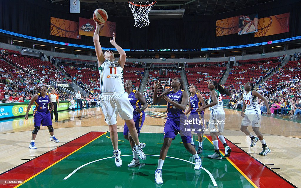 Ewelina Kobryn of the Seattle Storm goes to the basket against Nicky Anosike of the Los Angeles Sparks during the preseason game on May 13 2012 at...