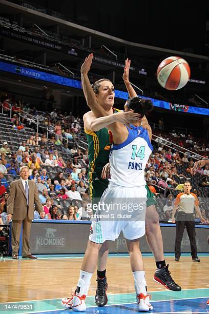 Ewelina Kobryn of the Seattle Storm passes the ball around the defense of Nicole Powell of the New York Liberty on June 30 2012 at the Prudential...