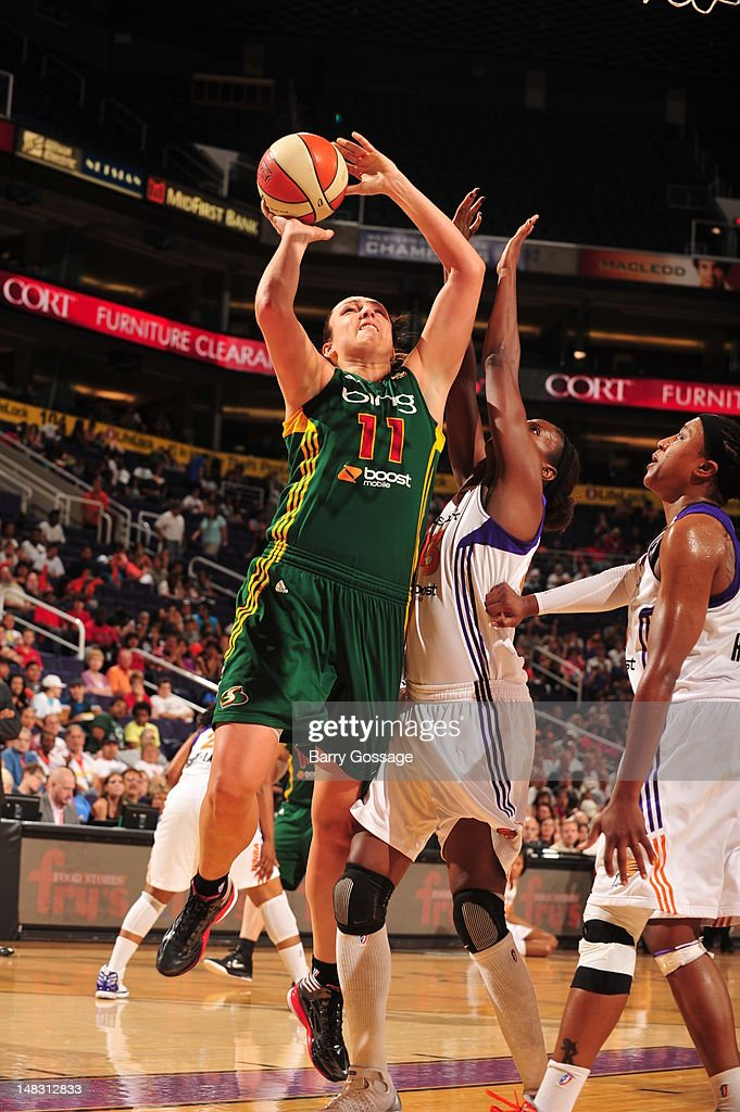 Ewelina Kobryn of the Seattle Storm shoots against Nakia Sanford of the Phoenix Mercury on July 13 2012 at US Airways Center in Phoenix Arizona NOTE...