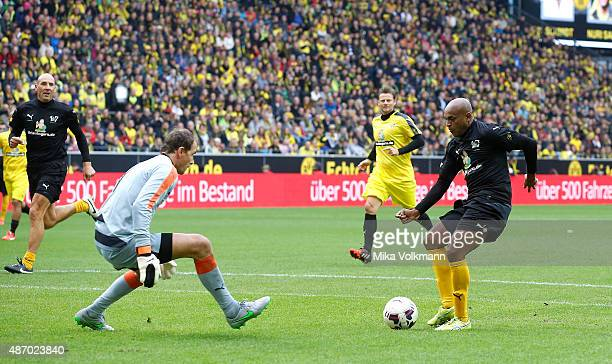 Ewerthon of Dedes world selection challenges goalkeeper Jens Lehmann of Dedes national team during the farewell match of Dede at Signal Iduna Park on...