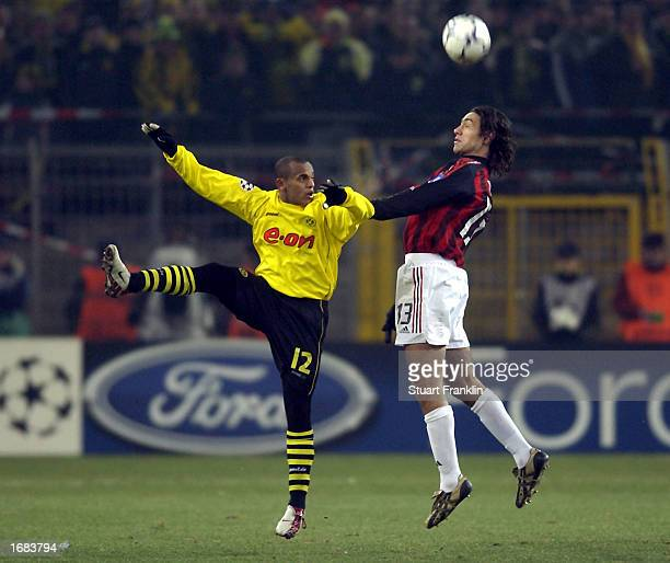 Ewerthon of Dortmund Alessandro Nesta of AC Milan during The Champions league match between Borussia Dortmund and AC Milan at The Westfalen Stadium...