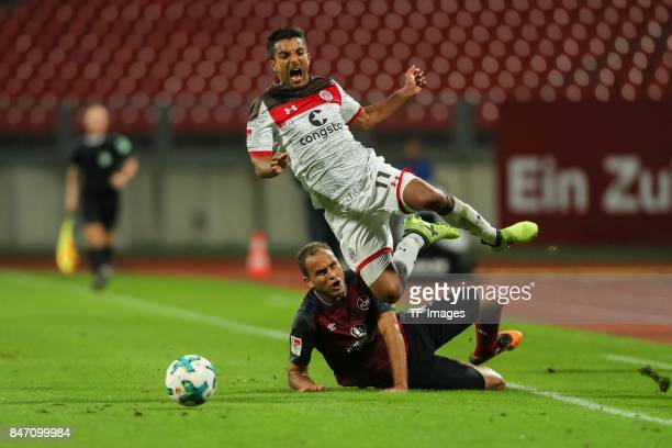 Ewerton Jose Almeida Santos of Nuernberg und Sami Allagui of St Pauli battle for the ball during the Second Bundesliga match between 1 FC Nuernberg...