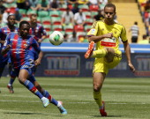 Ewerton of FC Anji Makhachkala is challenged by Ahmed Musa of PFC CSKA Moscow during the Russian Cup Final match between FC Anji Makhachkala and PFC...
