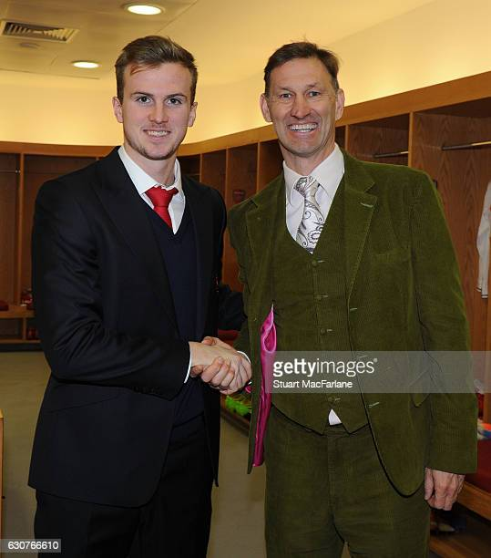 Ex Arsenal captain Tony Adams poses with current player Rob Holding in the home changing room before the Premier League match between Arsenal and...