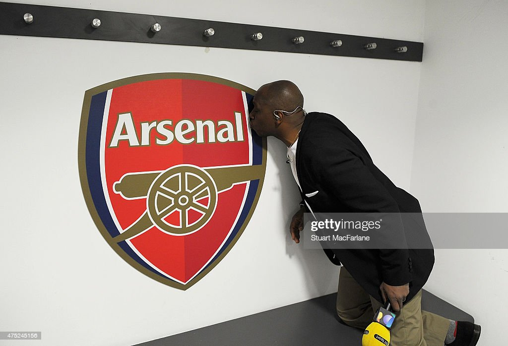 Ex Arsenal footballer and now TV pundit Ian Wright kisses the Arsenal crest in the Arsenal changing room before the FA Cup Final between Aston Villa...