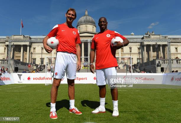 Ex Arsenal Legend's Tony Adams and Ian Wright pose for the camera during the Vodafone 4G Goes Live Launch at Trafalgar Sq on August 29 2013 in London...