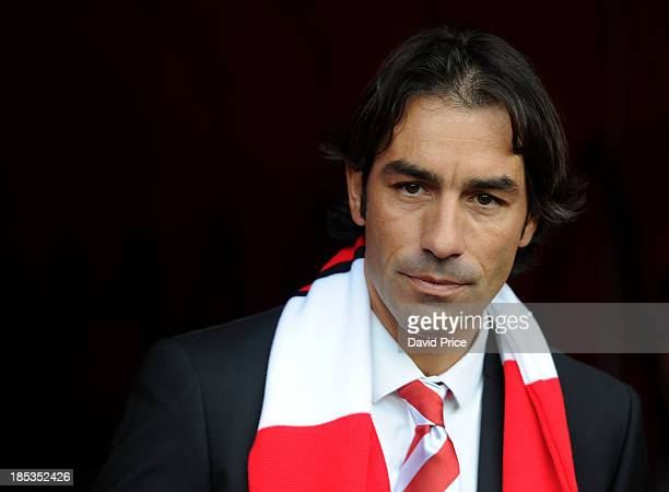 Ex Arsenal player Robert Pires looks on during the Barclays Premier League match between Arsenal and Norwich City at Emirates Stadium on October 19...