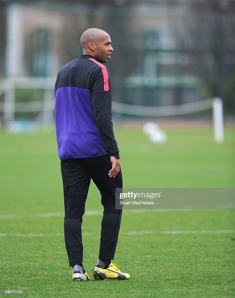Ex Arsenal player <a gi-track='captionPersonalityLinkClicked' href=/galleries/search?phrase=Thierry+Henry&family=editorial&specificpeople=167275 ng-click='$event.stopPropagation()'>Thierry Henry</a> during a training session at London Colney on December 28, 2012 in St Albans, England.