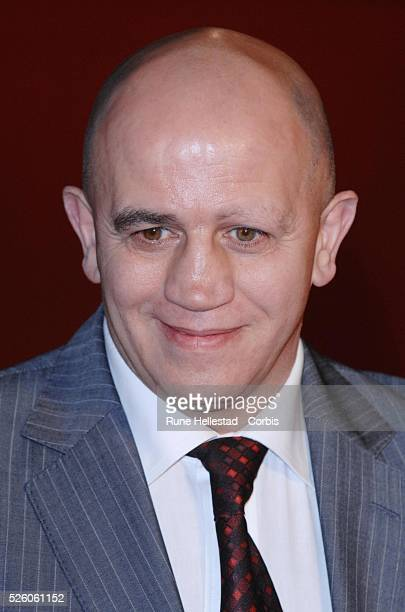 Ex boxer Alan Minter poses as he arrives for the British premiere of 'Rocky Balboa' at The Vue Cinema in London's Leicester Square