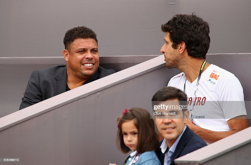 Ex Brazilian and Real Madrid footballer Ronaldo and Brazilian tennis player <a gi-track='captionPersonalityLinkClicked' href=/galleries/search?phrase=Marcelo+Melo&family=editorial&specificpeople=4278628 ng-click='$event.stopPropagation()'>Marcelo Melo</a> watch Jamie Murray of Great Britain and Bruno Soares of Brazil in action against Henri Kontinen of Finland and John Peers of Australia in their doubles match during day six of the Mutua Madrid Open tennis tournament at the Caja Magica on May 05, 2016 in Madrid,Spain
