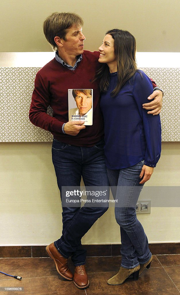 Ex bullfighter Manuel Diaz 'El Cordobes' and Virgina Troconis sign copies of his book 'De frente y por derecho' accompanied by his wife Virginia Troconis on January 17, 2013 in Malaga, Spain.