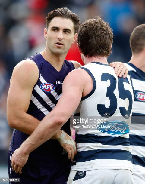 Ex Cats player Shane Kersten of the Dockers hugs former teammate Patrick Dangerfield of the Cats during the 2017 AFL round 14 match between the...