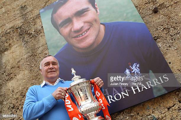 Ex Chelsea Football player Ron Harris poses with the FA Cup as the trophy takes a tour at Stamford Bridge on April 9 2010 in London England